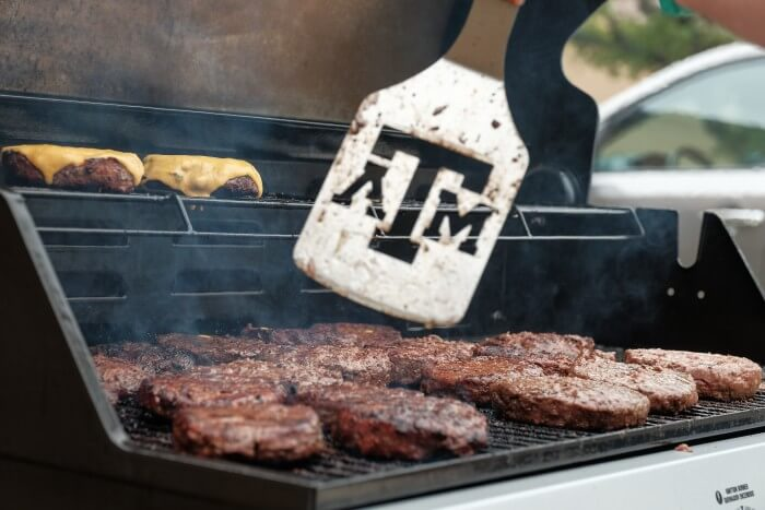 Grilling Texas burgers at Tiffin House
